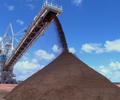 Iron ore bounces off 21-month low but glut still a drag
