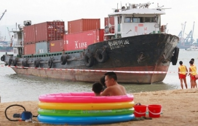 Chinese feeder forced ashore on Hong Kong beach