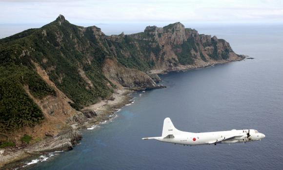 China says Japan fighter jets shadowed its planes over disputed waters