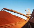 Iron Ore Surges Toward $60 as Steel `Exuberance' Bolsters Buying